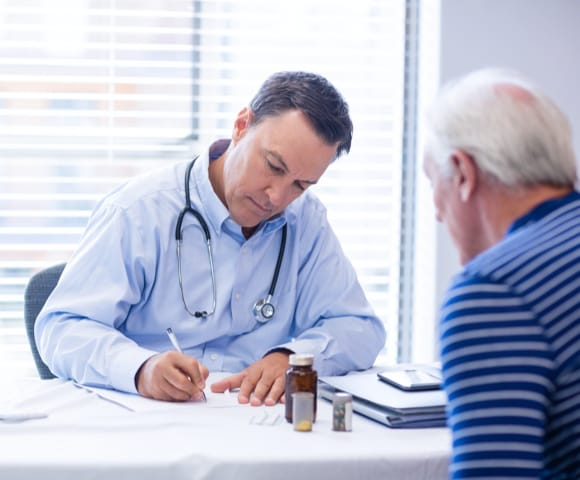 Physician telling patient to book home blood draw